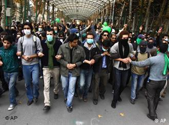 This photo, taken by an individual not employed by the Associated Press and obtained by the AP outside Iran shows pro-reform Iranian students, marching during their protest at the Tehran University campus in Tehran, Iran, Monday, Dec. 7, 2009. Security forces and pro-government militiamen clashed with protesters shouting death to the dictator outside Tehran University on Monday, beating men and women with batons and firing tear gas, on a day of nationwide student demonstrations, witnesses said. (AP Photo) This content is intended for editorial use only. For other uses, additional clearances may be required. EDITORS NOTE AS A RESULT OF AN OFFICIAL IRANIAN GOVERNMENT BAN ON FOREIGN MEDIA COVERING SOME EVENTS IN IRAN, THE AP WAS PREVENTED FROM INDEPENDENT ACCESS TO THIS EVENT