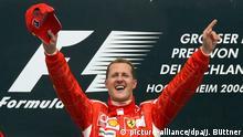 ARCHIV - Der deutsche Ferrari Formel-1-Pilot Michael Schumacher jubelt nach seinem Sieg beim Großen Preis von Deutschland auf dem Hockenheimring (Archivfoto vom 30.07.2006). Das Weihnachtsgeschenk für die Formel 1 ist nach Informationen von «Bild.de» perfekt: Michael Schumacher kehrt laut Homepage der «Bild»-Zeitung zurück in die Königsklasse des Motorsports. Für ein Jahr soll der Kerpener, der am 3. Januar seinen 41. Geburtstag feiert, für den neuen Rennstall Mercedes Grand Prix Gas geben. Foto: Jens Büttner (zu dpa 0067 vom 23.12.2009) +++(c) dpa - Bildfunk+++ | Verwendung weltweit