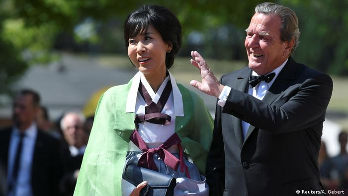 Schroeder and his wife Soyeon Kim arrive for the opening of the Bayreuth Wagner Festival at the Richard Wagner Festival Hall in Bayreuth, Germany July 25, 2019
