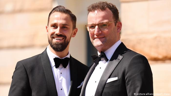 Jens Spahn stands next to his partner, Daniel Funke, wearing tuxedos