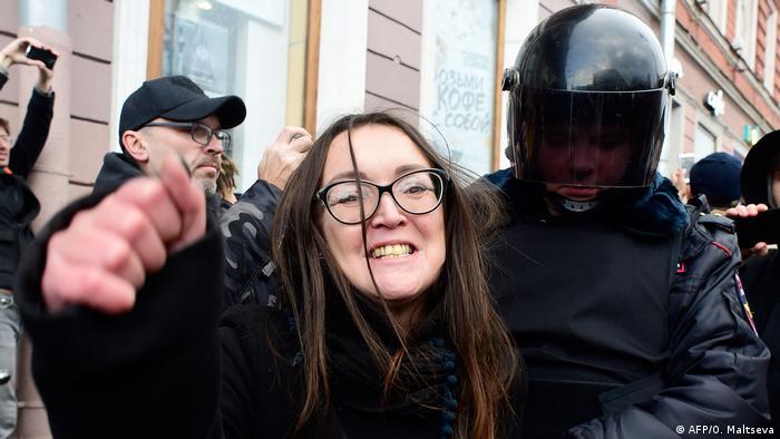 Yelena Grigorieva with police