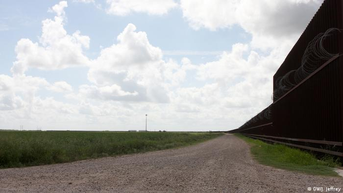 East of McAllen, Texas, stretching for miles along the border, is a wall built in the 2000s