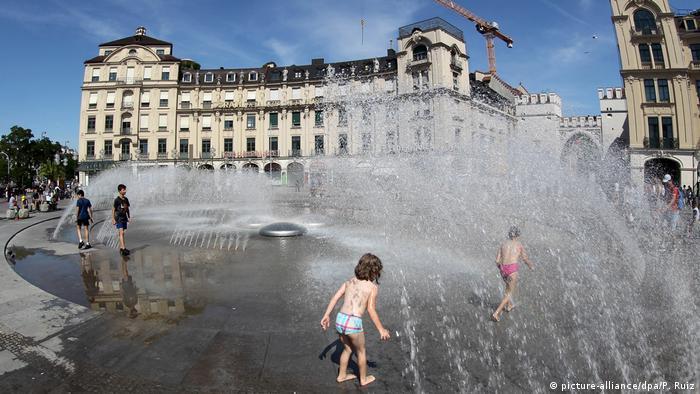 Kids in a fountain in Munich