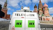 A Russia's state-controlled Russia Today (RT) television broadcast van is seen parked in front of St. Basil's Cathedral and the Kremlin next to Red Square in Moscow on March 16, 2018. Russia will vote for President on March 18. / AFP PHOTO / Mladen ANTONOV (Photo credit should read MLADEN ANTONOV/AFP/Getty Images)