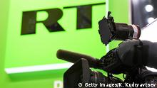 Логотип RT и телекамера