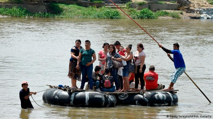 A group of migrants from Guatemala use a makeshift raft to illegally cross the Suchiate River