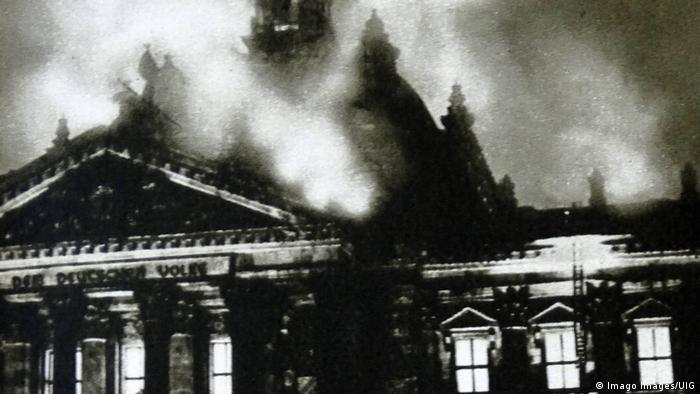 A photo shows the 1933 fire in the Reichstag building that helped the Nazis seize power (Imago Images/UIG)