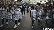 Demonstrators march with photos of murdered activists during a protest march, in Bogota, Colombia, Friday, July 26, 2019. Colombians took to the streets to call for an end to a wave of killings of leftist activists in the wake of the nation's peace deal. (AP Photo/Ivan Valencia) |