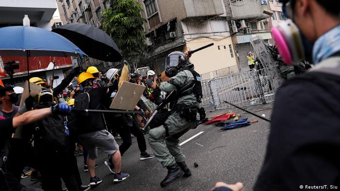 Demonstrators in Yuen Long clash with police during a protest against the Yuen Long attacks