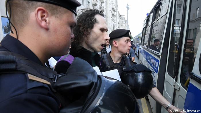 A demonstrator is detained ahead of Saturday's protest in Moscow