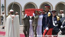 Military officers carry the coffin of late president Beji Caid Essebsi during his state funeral at the presidential palace in the capital's eastern suburb of Carthage, Saturday July 27, 2019. Many Tunisian and visiting international dignitaries have gathered for the funeral of Essebsi, the country's first elected head of state who died aged 92. (Fethi Belaid / Pool via AP)