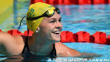 Australia's Shayna Jack smiles after the swimming women's 50m freestyle qualifications during the 2018 Gold Coast Commonwealth Games at the Optus Aquatic Centre in the Gold Coast on April 6, 2018 / AFP PHOTO / MANAN VATSYAYANA (Photo credit should read MANAN VATSYAYANA/AFP/Getty Images)