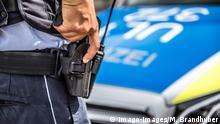 Themenbild Polizei, Polizei, Streifenwagen, Polizist mit Handschellen, Polizist mit Dienstpistole Baden-Württemberg Deutschland *** Theme Copyright: x©xonw-images.de/MarkusxBrandhuberx