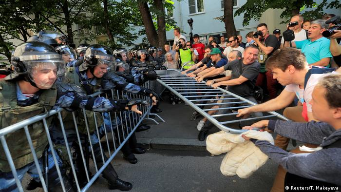 Opposition protesters face police in Moscow on Saturday