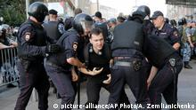 July 27, 2019*** Police officers detain a man during an unsanctioned rally in the center of Moscow, Russia, Saturday, July 27, 2019. Russian police are wrestling with demonstrators and have arrested hundreds in central Moscow during a protest demanding that opposition candidates be allowed to run for the Moscow city council. (AP Photo/Alexander Zemlianichenko)