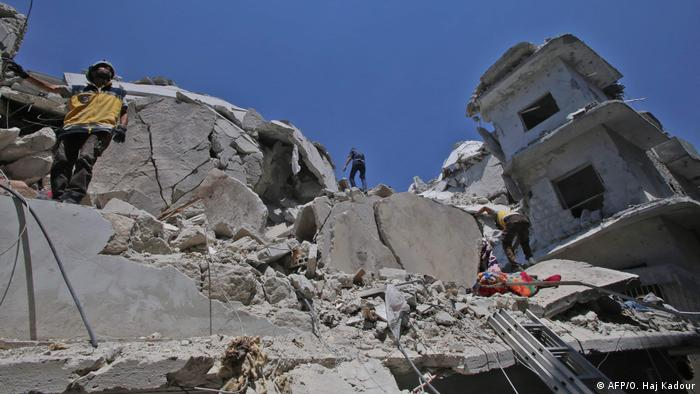Buildings in Ariha damaged by the airstrikes