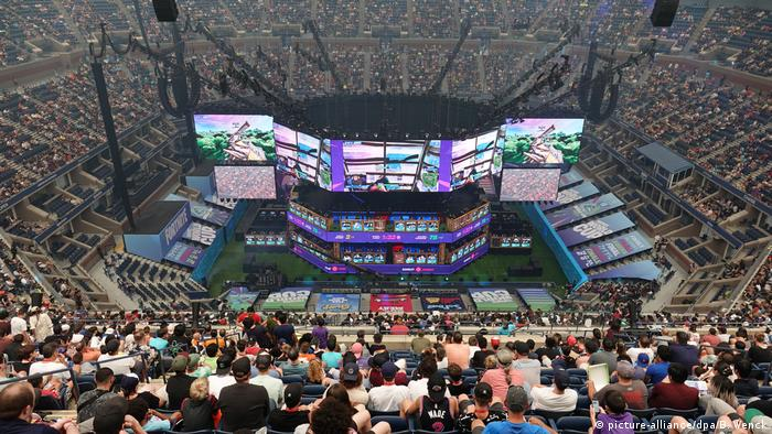 People sit in an arena to watch the Fortnite World Cup
