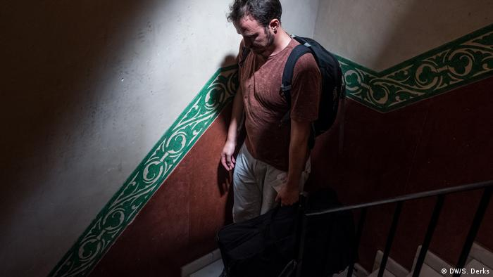 A man walking down a flight of stairs