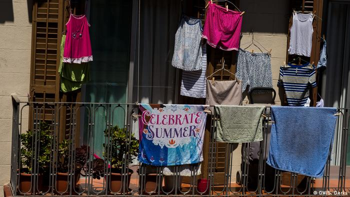 Clothes hanging from washing lines on a balcony