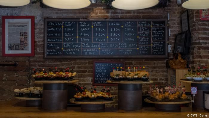 Various pinchos lined up in a bar