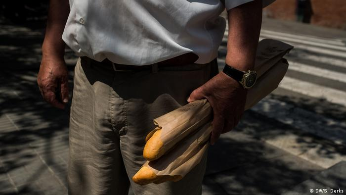 A man carrying bread