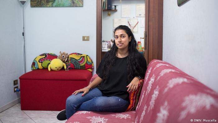 Nair poses for a portrait in her bedroom