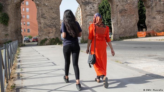 Two Bangladeshi women walking down a street in Rome