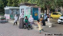 Bangladeshi women with their kids in a square of Torpignattara