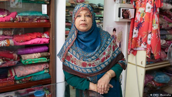 Sultana poses for a portrait in her shop