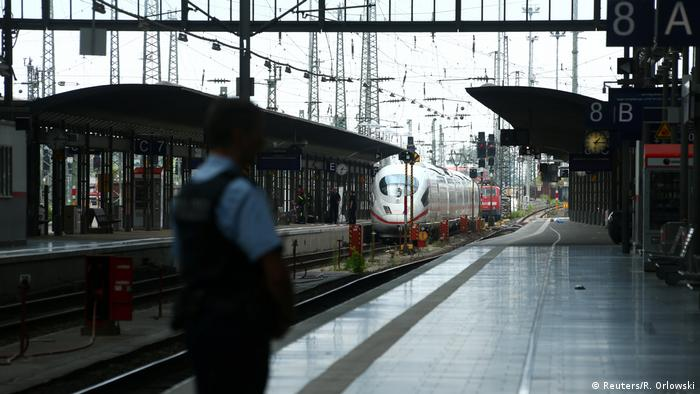 Police secures a platform at the main train station in Frankfurt, Germany, July 29, 2019, after a 40-year-old man of African origin pushed an eight-year-old boy in front of an oncoming train, killing him, police said.