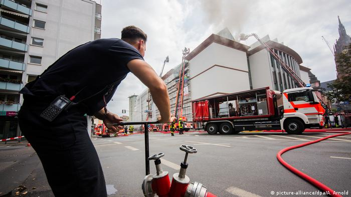 A fireman in Frankfurt opens a fire hydrant to put out a fire at a museum