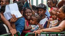 June 27, 2019*** TOPSHOT - Migrants of different nationalities queue at the Mexican National Institute of Migration in Tapachula, Chiapas State, Mexico, near the Guatemalan border, on June 27, 2019. - Guatemala is a starting and transit point for migrant caravans that have since last year embarked for Mexico and the US border, angering US President Donald Trump and inflaming tensions between Washington and its southern neighbours. Most of the migrants are from Central America, but others have joined the caravans from other countries on the continent such as Colombia and Cuba, and even as far afield as Africa. (Photo by QUETZALLI BLANCO / AFP) (Photo credit should read QUETZALLI BLANCO/AFP/Getty Images)