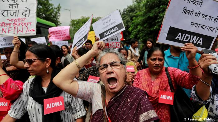 Activists shout slogans during a protest against sexual violence in India (Reuters/D. Diddiqui)