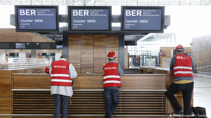 Visitors at Berlin's unfinished airport