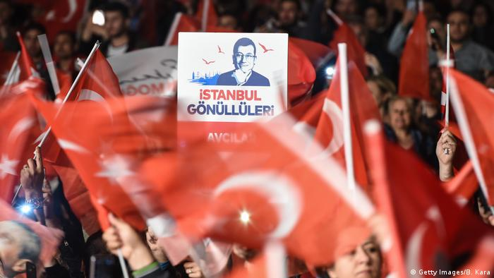 Supporters of Istanbul mayor Ekrem Imamoglu cheer as they protest the rerun of Istanbul election ordered by Turkey's election commission