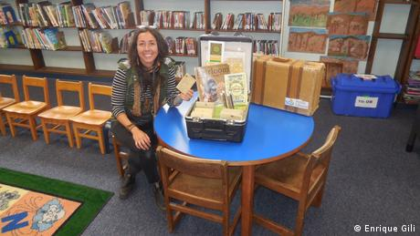 Librarian and horticulturalist Destiny Rivera with her seed library at the San Diego Ocean Beach Public Library