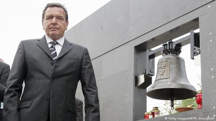 German Chancellor Gerhard Schröder is seen after he burned a candle in front of the bell dedicated to the commander of the 1944 Warsaw Uprising