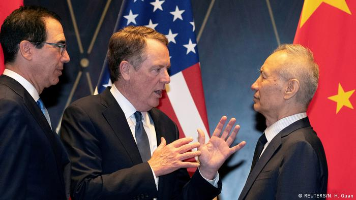 U.S. Trade Representative Robert Lighthizer gestures as he chats with Chinese Vice Premier Liu He, while Treasury Secretary Steven Mnuchin looks on, after posing for a family photo at the Xijiao Conference Center in Shanghai, China, July 31, 2019.