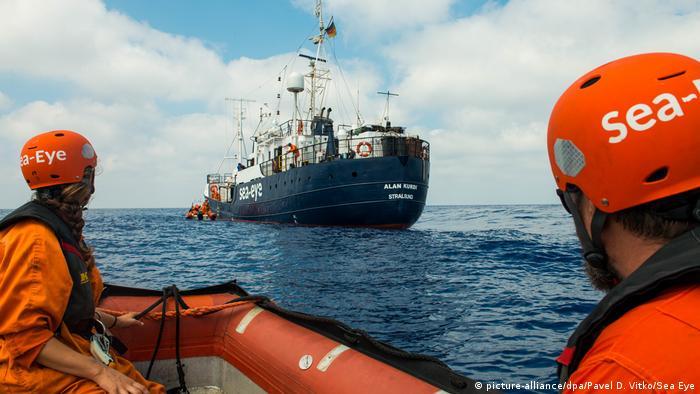 Sea-Eye rescuers look at the Alan Kurdi vessel
