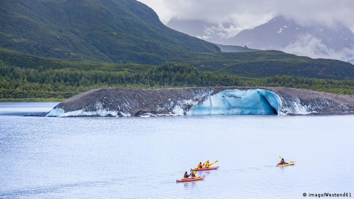 Kayakers on Valdez Glacier Lake in Alaska