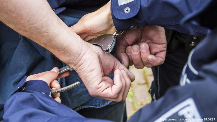 A suspect is handcuffed by police