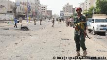 (190801) -- ADEN, Aug. 1, 2019 (Xinhua) -- A soldier secures a car bombing site near a police station in Aden, Yemen, Aug. 1, 2019. A car bombing attack struck a police station on Thursday in Aden s neighborhood of Sheikh Othman, killing four security members and injuring 20 others at the scene. No group immediately claimed responsibility for the car bomb attack, but the security source blamed it on extremist groups. (Photo by Murad Abdo/Xinhua) YEMEN-ADEN-CAR BOMBING-POLICE STATION PUBLICATIONxNOTxINxCHN