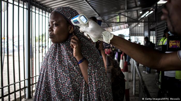 A woman gets her temperature measured a screening station in DRC (Getty Images/AFP/J. Wessels)
