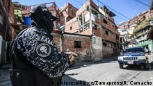 January 25, 2019 - Caracas, Venezuela - A member of the Bolivarian National Police Special Forces ('FAES' in Spanish) seen taking position during a Police raid operation against criminal groups at Petare slum in Caracas |