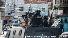 January 25, 2019 - Caracas, Venezuela - Members of the Bolivarian National Police Special Forces ('FAES' in Spanish) seen taking position inside an armored vehicle during a Police raid operation against criminal groups at Petare slum in Caracas |