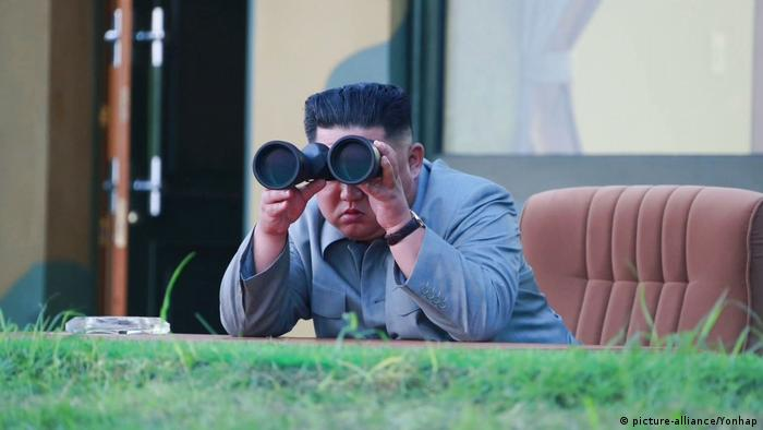 North Korean leader Kim Jong Un observes a missile test on July 31