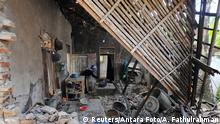 A woman is seen inside her house damaged after an earthquake hit in Pandeglang, Banten province, Indonesia, August 3, 2019. Antara Foto/Asep Fathulrahman/ via REUTERS. ATTENTION EDITORS - THIS IMAGE WAS PROVIDED BY A THIRD PARTY. MANDATORY CREDIT. INDONESIA OUT
