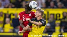 Bayern Munich's Kingsely Coman and Borussia Dortmund's Lukasz Piszczek battle for the ball. (picture-alliance/dpa/G. Kirchner)