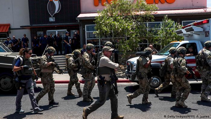Law enforcement agencies respond to an active shooter at a Wal-Mart near Cielo Vista Mall in El Paso, Texas