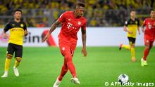 Bayern Munich's German defender Jerome Boateng plays the ball during the German Supercup foorball match BVB Borussia Dortmund v FC Bayern Munich on August 3, 2019 at the Signal Iduna Park in Dortmund, western Germany. (Photo by INA FASSBENDER / AFP) / DFL REGULATIONS PROHIBIT ANY USE OF PHOTOGRAPHS AS IMAGE SEQUENCES AND/OR QUASI-VIDEO (Photo credit should read INA FASSBENDER/AFP/Getty Images)